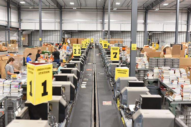 employees working in warehouse distribution center for textbooks
